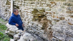 Stonemason Dan Newbery during work on north wall